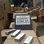 Apreendido: Divididos em várias caixas, maços foram encontrados por agentes do posto de Nhangapí, em Itatiaia (Foto: Divulgação/Operação Barreira Fiscal)