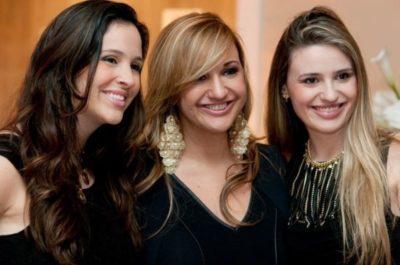 A promoter Ana Paula Delgado (aniversariante do dia) entre as filhas Amanda e Stephanie